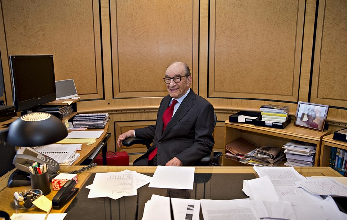 "This photo taken Oct. 18, 2013 shows economist Alan Greenspan in his office in Washington. For 18½ years as Federal Reserve chairman, he was rhapsodized for helping drive a robust U.S. economy. Yet soon after he stepped down in 2006, public judgment reversed course: He was engulfed by accusations that he helped cause the 2008 financial crisis _ the worst since the 1930's. Now, Greenspan has struck back at any notion that he _ or anyone _ could have known how or when to defuse the threats that triggered the crisis. He argues in a new book, ""The Map and the Territory,"" that traditional economic forecasting is no match for the irrational risk-taking that can inflate catastrophic price bubbles in assets like homes or tech stocks. Greenspan, now 87, work as a private consultant. The former chief of America's monetary policy, now 87, writes about the difficulty of predicting economic problems in his new book: ""The Map and the Territory: Risk, Human Nature, and the Future of Forecasting."" (AP Photo/J. Scott Applewhite)"